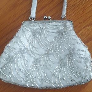 Silver beaded cluth